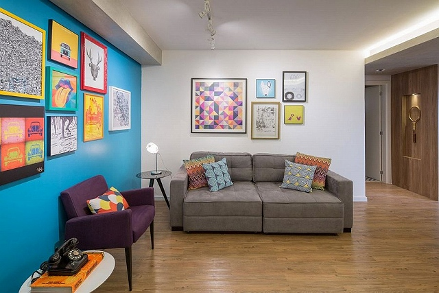 Accent-blue-wall-and-colorful-wall-art-in-the-living-room.jpg