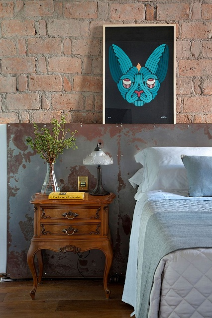 Distressed-finishes-and-antique-decor-make-a-splash-in-the-modern-industrial-bedroom.jpg