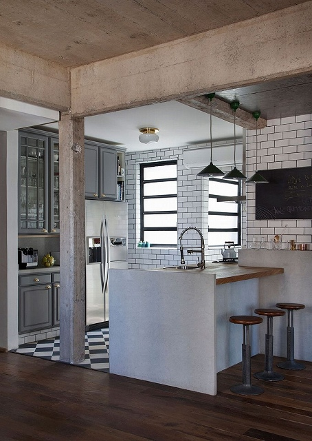Gray-cabinets-and-tiles-separate-the-kitchen-from-the-small-living-space.jpg
