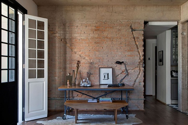 Home-workspace-with-table-on-wheels-and-exposed-brick-wall.jpg