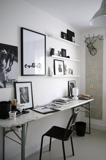 Industrial-home-office-features-a-sleek-desk-with-weathered-look.jpg