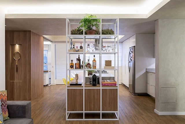 Open-metallic-shelf-serves-both-the-kitchen-and-living-area.jpg