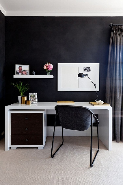 Small-home-workspace-with-a-dark-backdrop-and-sleek-desk-in-white.jpg