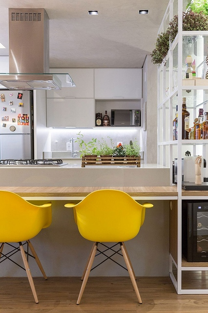 Yellow-accents-add-brightness-to-the-stylish-and-innovative-kitchen.jpg