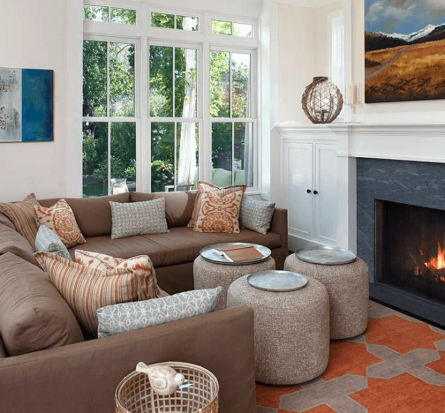 brown-couch-and-contrasting-fire-place.jpg