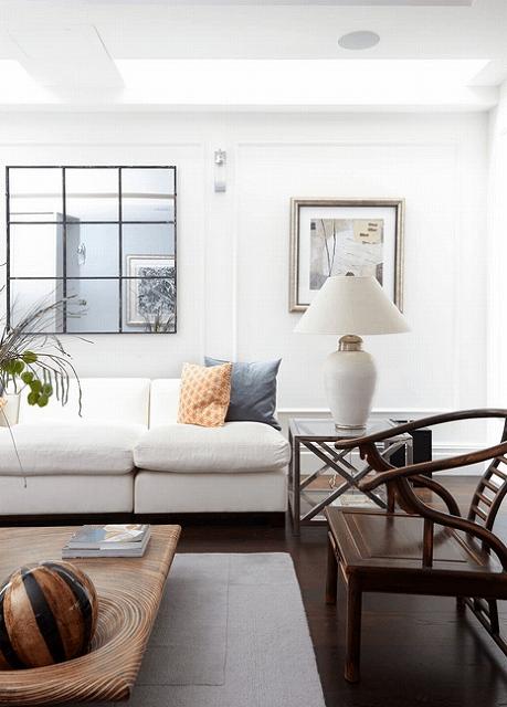 framed-mirror-above-white-couch.jpg