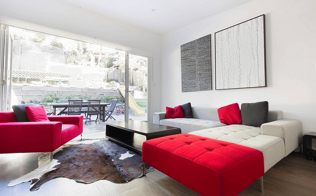 white-and-red-couches-with-lots-of-natural-light.jpg