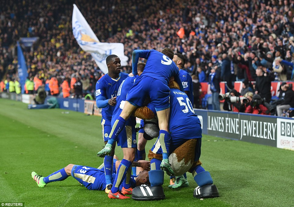 Ulloa is mobbed by his Leicester team-mates and Filbert the mascot