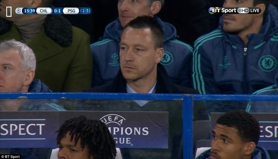 Chelsea captain John Terry who missed the Champions League last 16 clash through injury looks dejected after seeing his side concede