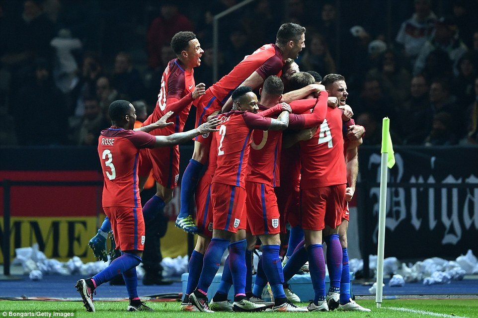 Dier is mobbed by his England team-mates after scoring what turned out to be the winning goal
